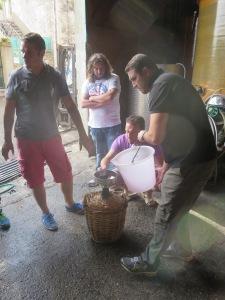 Transferring wine into the bidons