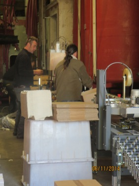 Jeff and Michel packing cases with the help of some...er.... high technology