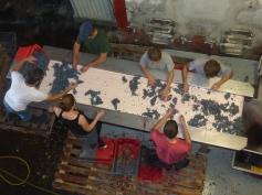 Sorting the last case, (clockwise from left) Vincent, James, Morgane, Julien, Charles, Priscilla